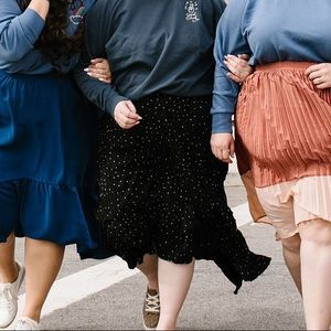 Black pleated polka dot skirt